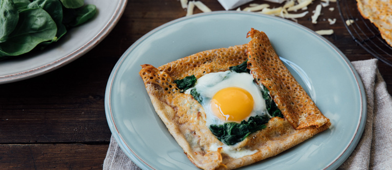 Buckwheat galettes with eggs, cheese, and spinach