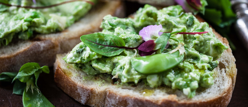 Avocado, pea and feta on toast